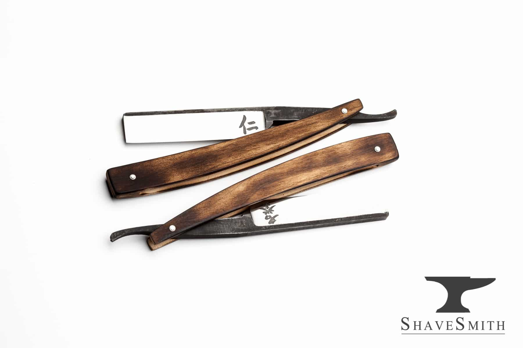 Only two materials are featured in this set: steel, maple. I've developed this set of razors merging the tradition of seven day straight razors sets, but drew inspiration from japanese motifs, and the seven principles of Bushido. Each straight razor has one of the japanese symbols engraved at the heel, representing the following principles that samurai would call upon. Rectitude  CourageBenevolencePolitenessVeracityHonorLoyaltyThe razors are then assigned unique places within the box, with matching marks engraved into the wood. The box itself is inspired by japanese toolboxes, using a unique locking mechanism for the lid that is a simple wood wedge.