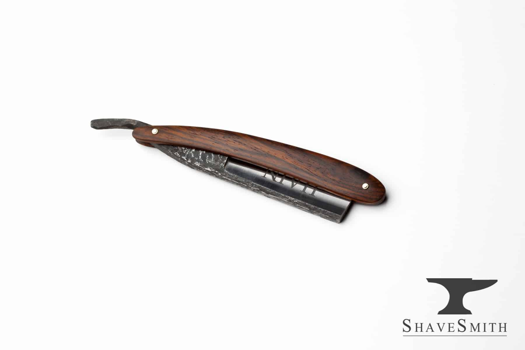 A simple, yet strong family name razor.   HAIN, deeply engraved in the blade face on the razor's presentation side, with a seaview engraving in the other side.   Build to be a nimble shaver, but stout to outlive us all. All cocobolo, rounded profile, and forged steel work together to make this simple piece feel visually fulfilling.